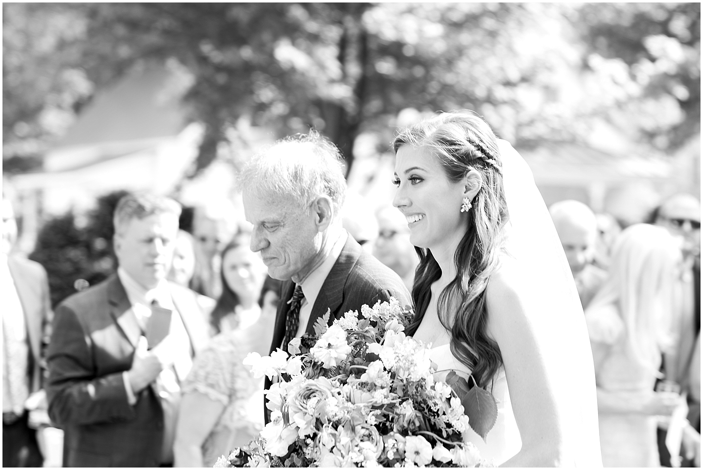 Father and bride walk down aisle Photos by Alyssa Parker Photography
