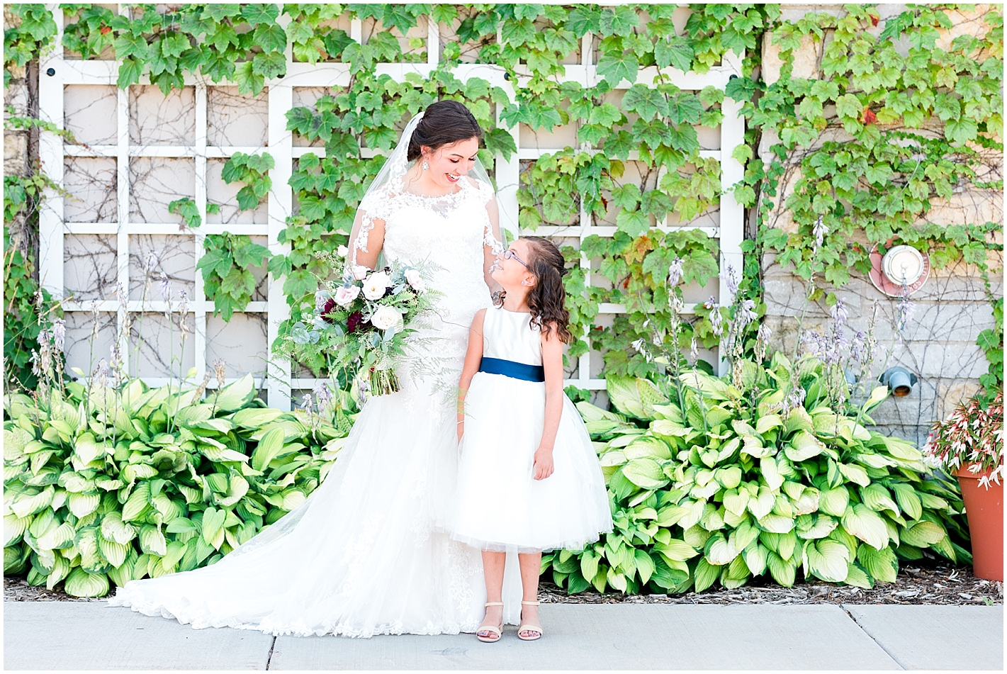 Bride and Flower Girl By Alyssa Parker Photography