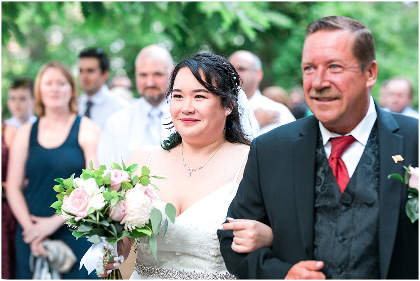 Father walks daughter down aisle photo by Alyssa Parker Photography