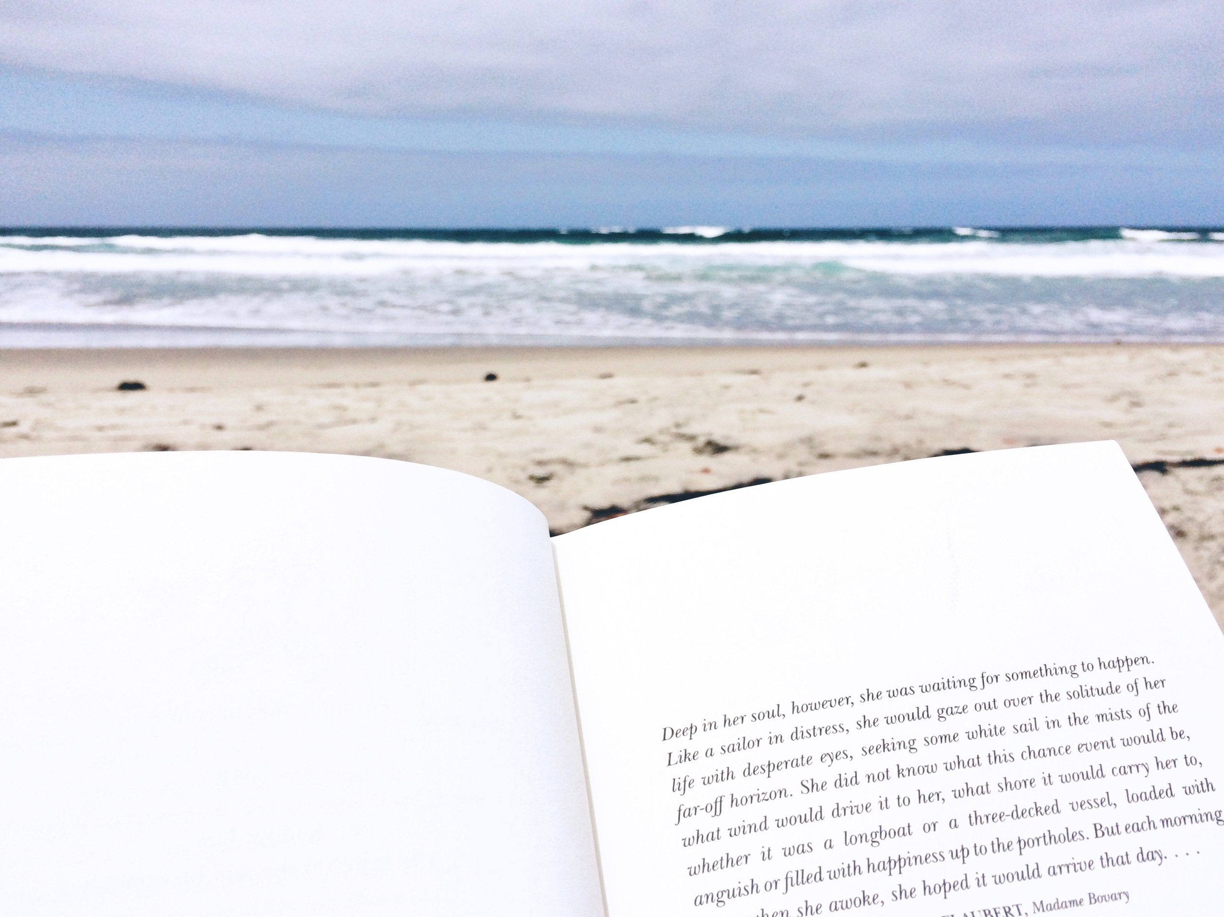 San Diego beach and book