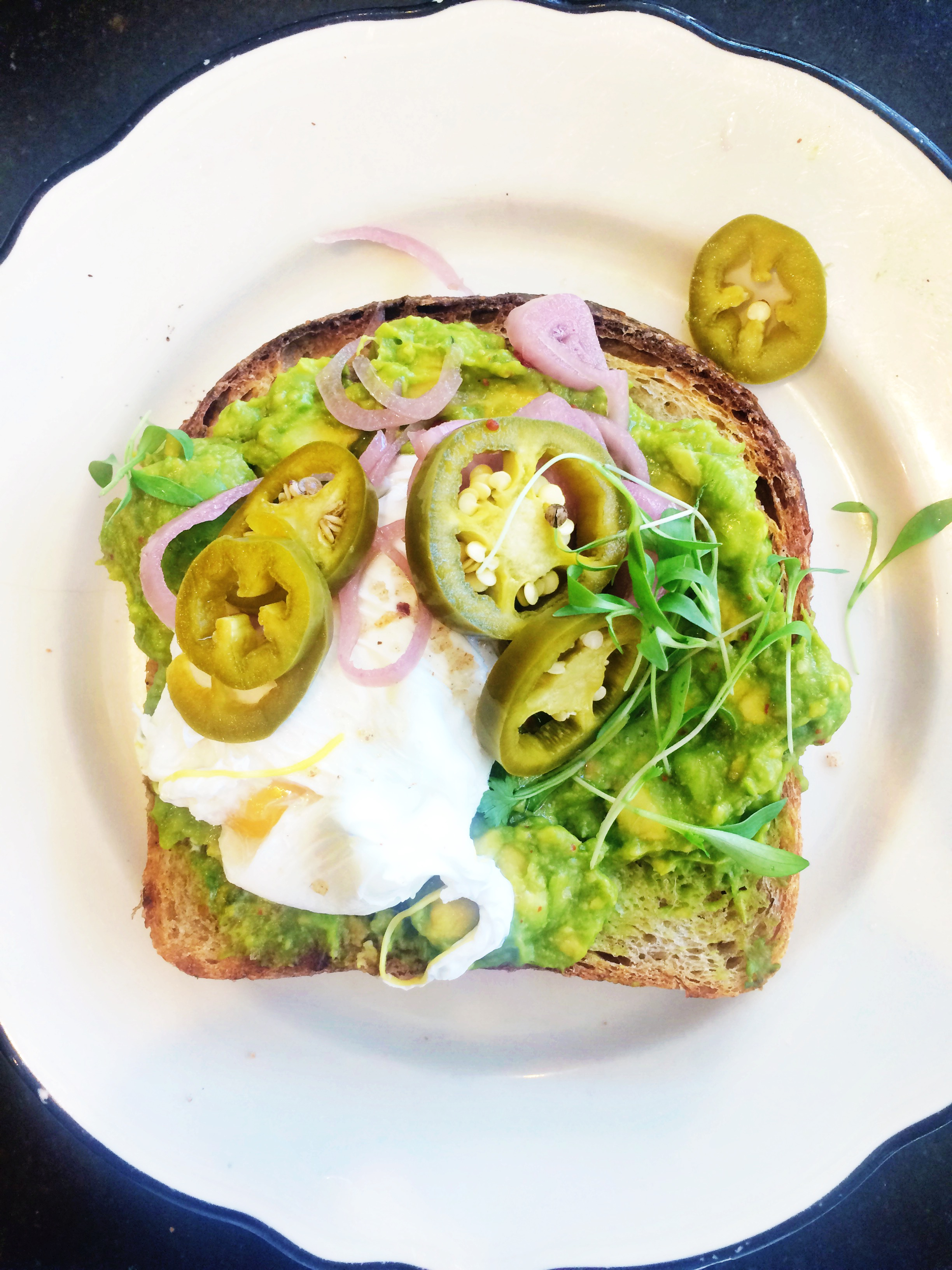 avocado toast with egg and jalepenos