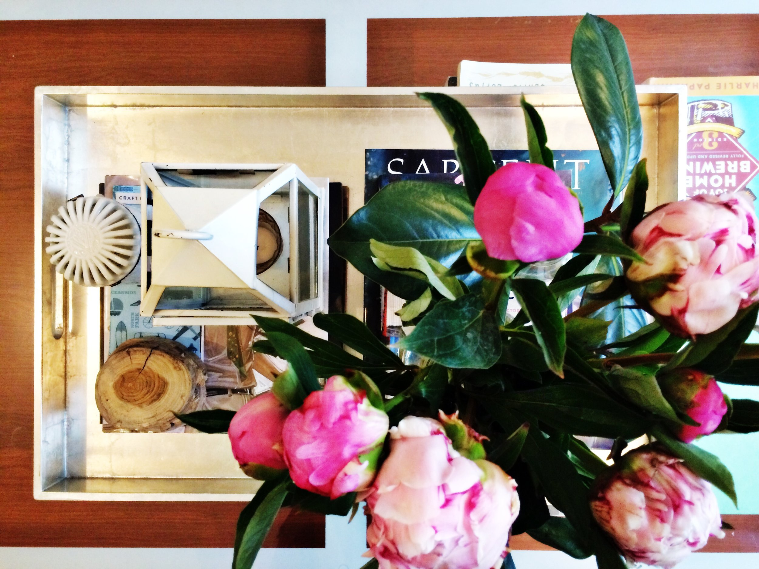 coffee table styling with peonies and west elm tray