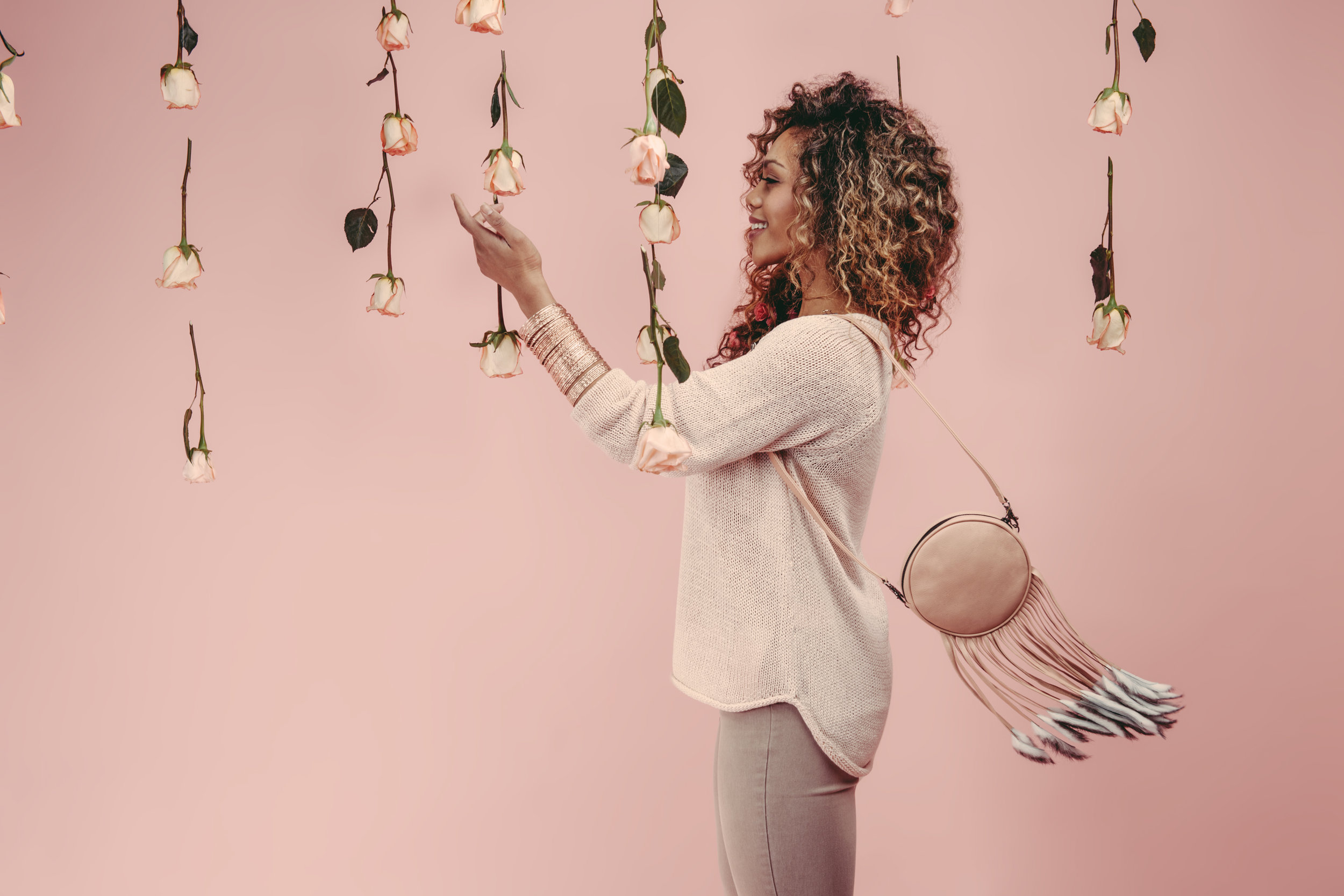 Blush-pink-rabbit-circle-round-fringed-fanny-pack-belt-bag-model.jpg