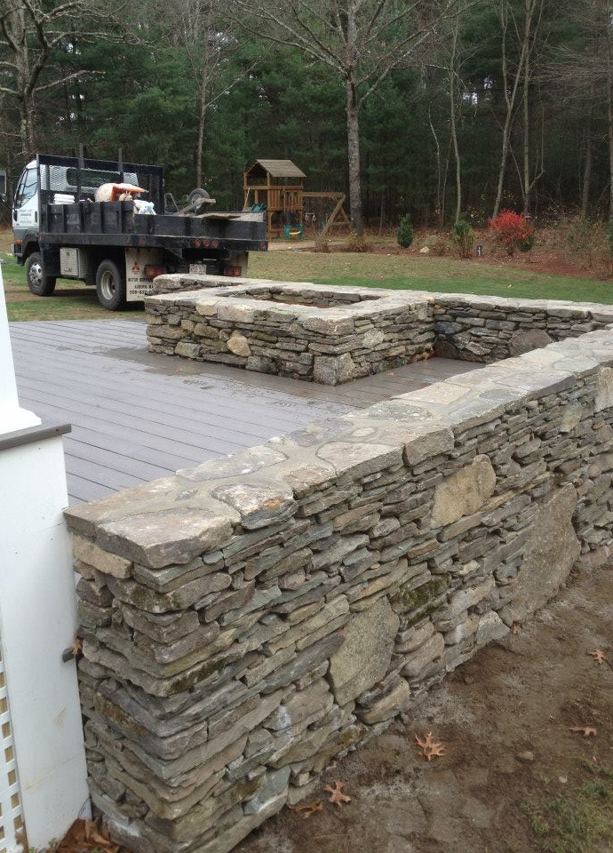 Fieldstone sitting wall added to porch