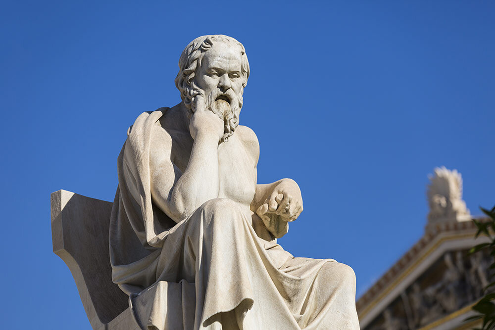 Socrates in a contemplative pose, perhaps wondering why it's so hard to get things done in the modern, distracting world of Athens, circa 400 BC.