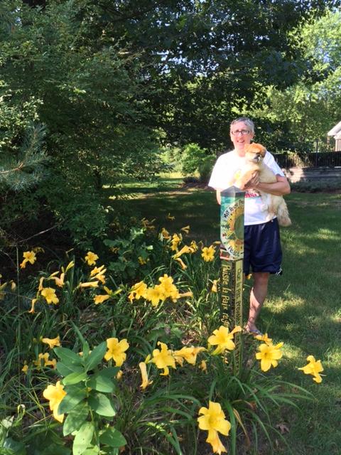 Dr. Blackburn with dog Mushu