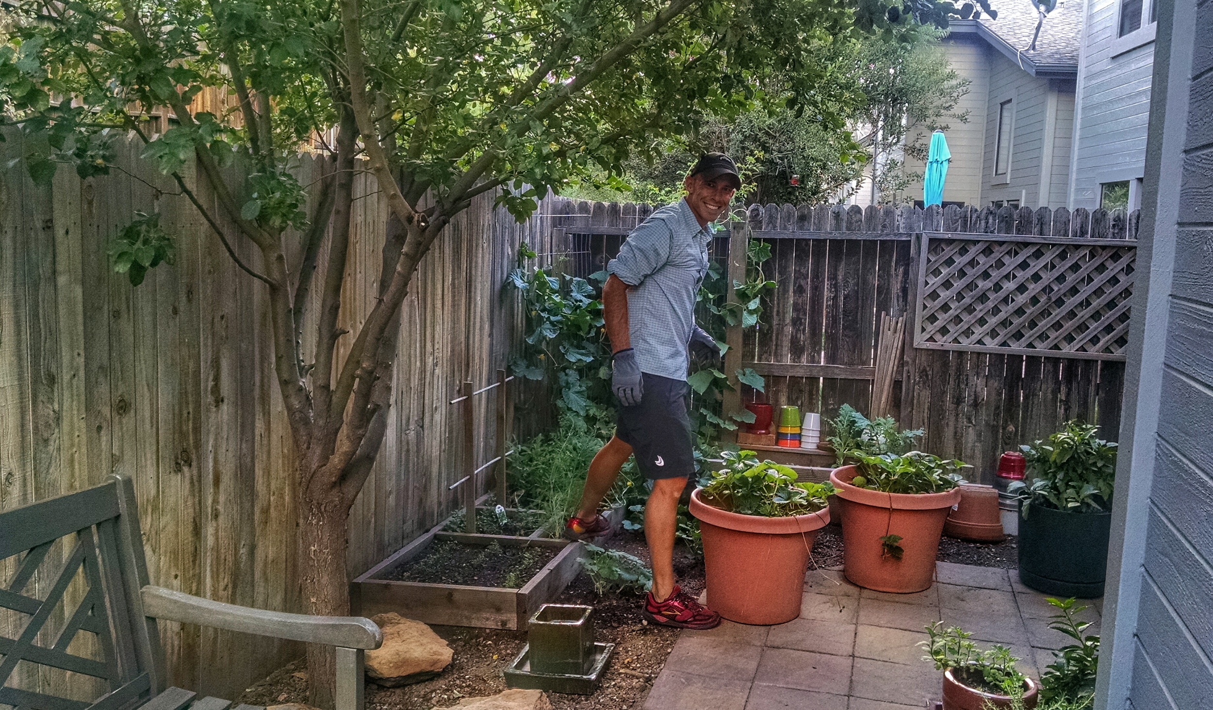 Here MattyB is working in our tiny little garden. We don't have a large backyard, but I am amazed at how much we can grow in such a tiny space. And it is so rewarding to be able to step right into your backyard for fresh produce for your meals.