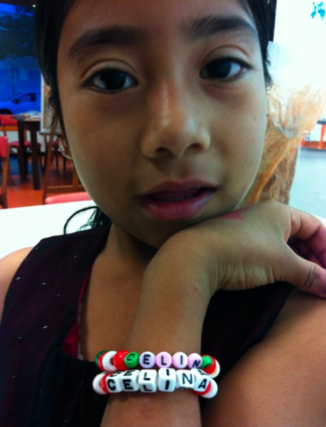 Every lady knows: playing with beads is REALLY fun!   Young Celina gets creative with beaded jewelry at Youth Interactive… looking good, girl!