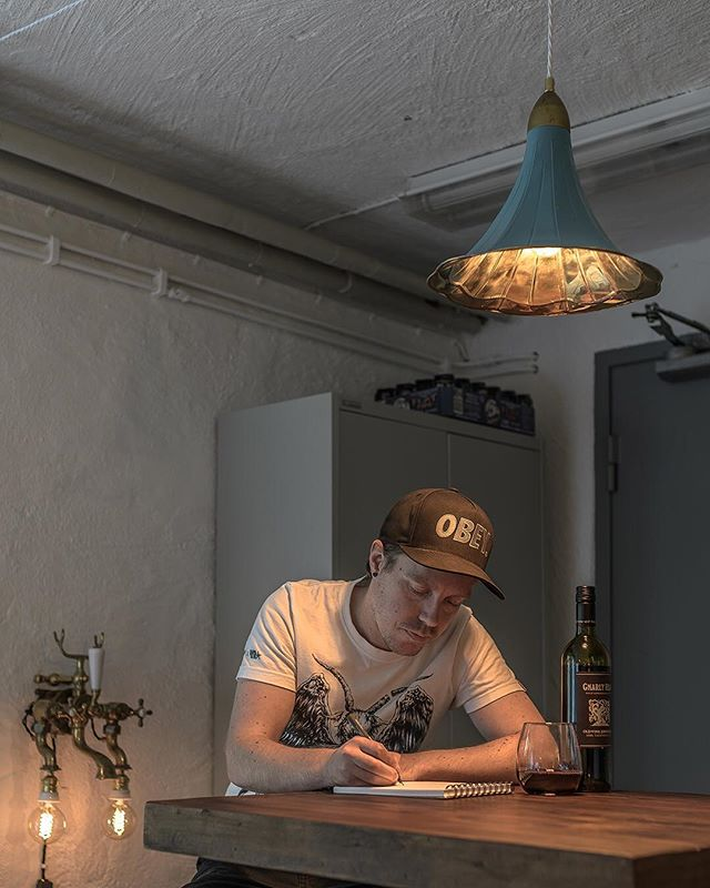Friday-afterwork-vibe in RustyOakStudio. Mr Oak sketching on some new graphic design miracles. Red wine is mandatory, of course. The weekend is soon here! Have a good one, folks! 🍷 . . . . . #RustyRemakes #CreativeDesign #Concept #Design #Designlamp #Decor #Idea #IconicLighting #Interior #Industrial #InteriorDesign #Industrialdesign #IndustrialDecor #Interior_Delux #Lamp #Lamps #Lightdesign #LightingDesign #MadeInSweden #Scandinaviandesign #Swedishdesign #Swedishdesigner #UniqueLamps #Vintage #Vintageindustrial #gocatchsomeswag #eekvisualart