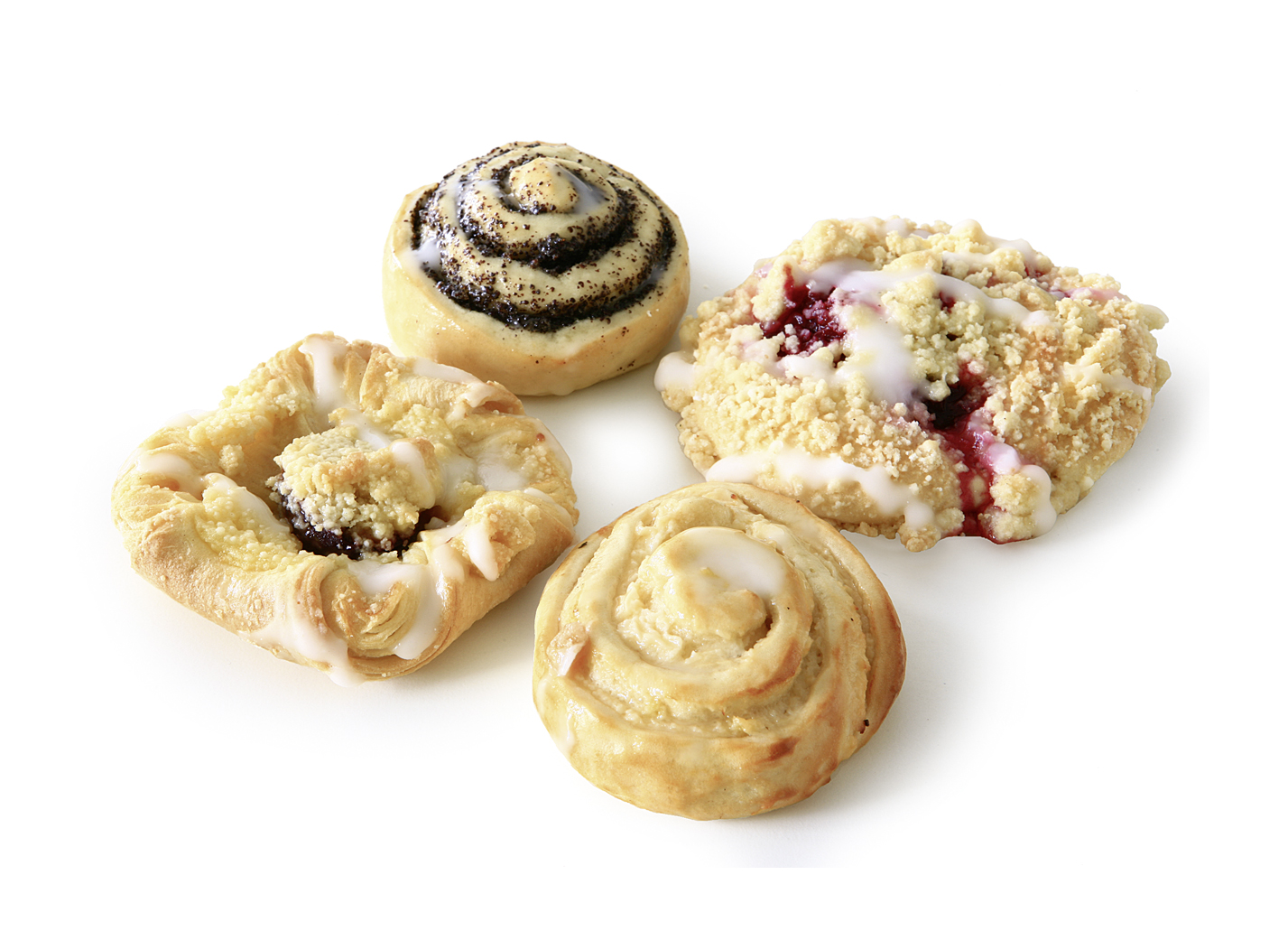 Selection of pastries - Mix of the varieties: cherry streusel snail, plum streusel puff pastry, poppy-yeast snail, apple-curd cheese yeast snail
