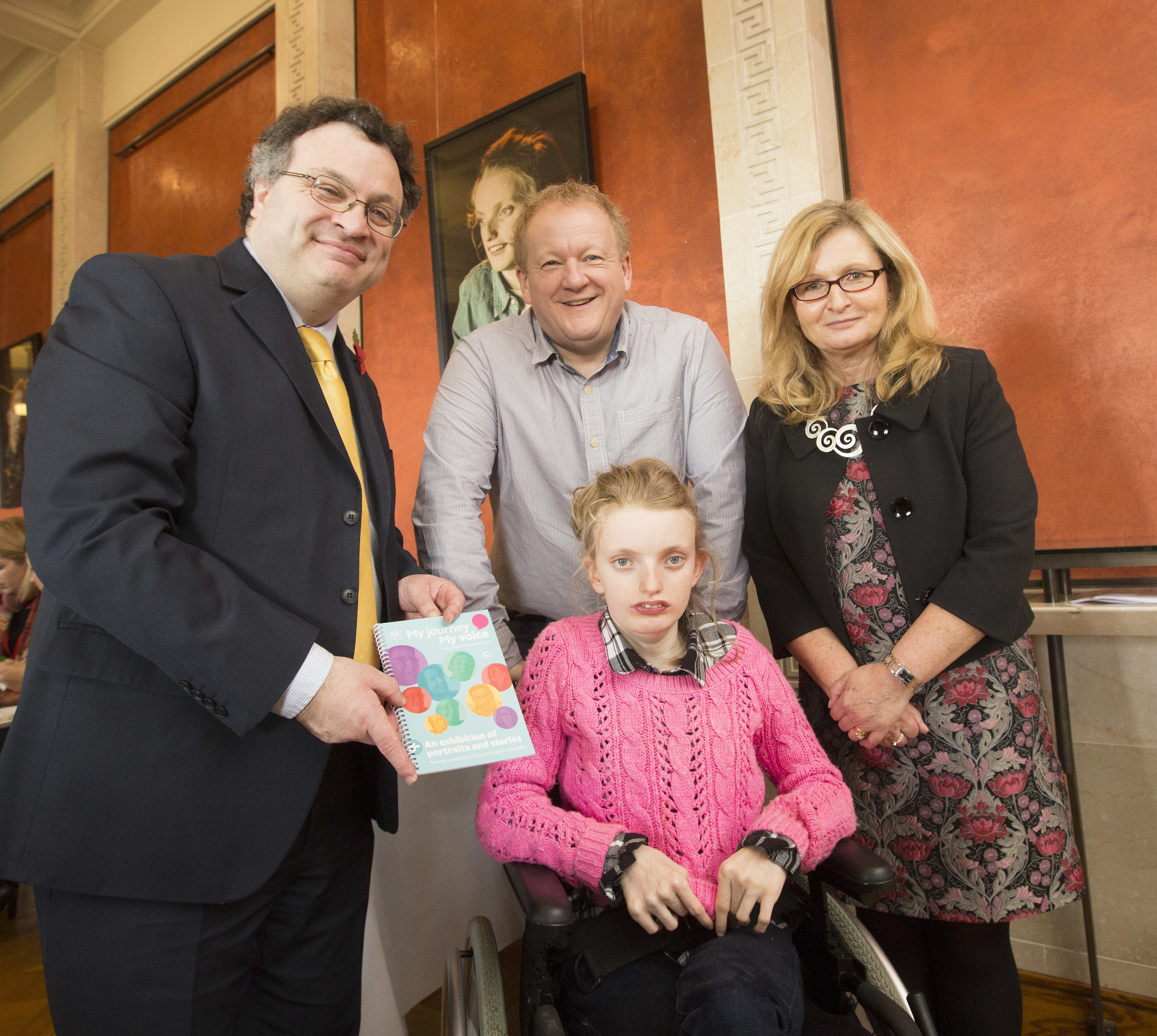 Pictured at the launch of   'My Journey, My Voice' multimedia portraits and stories exhibition to raise awareness of communication disability at Parliament Buildings, Stormont are (L-R) Minister for Employment and Learning Stephen Farry; Jemima Carlin and her dad and Alison McCullough, Royal College Speech and Language Therapist's