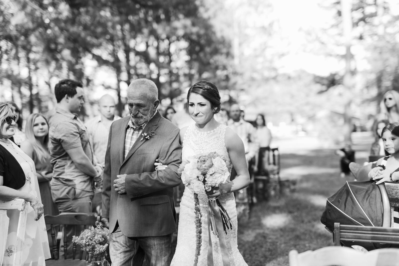 oklahoma wedding photographer pasture at willows ranch broken bow bride crying