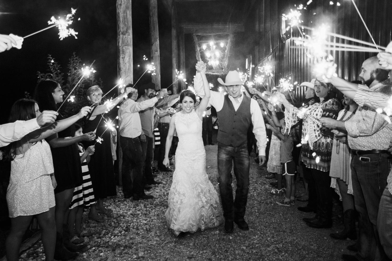 oklahoma wedding photographer pasture at willows ranch broken bow reception sparkler exit