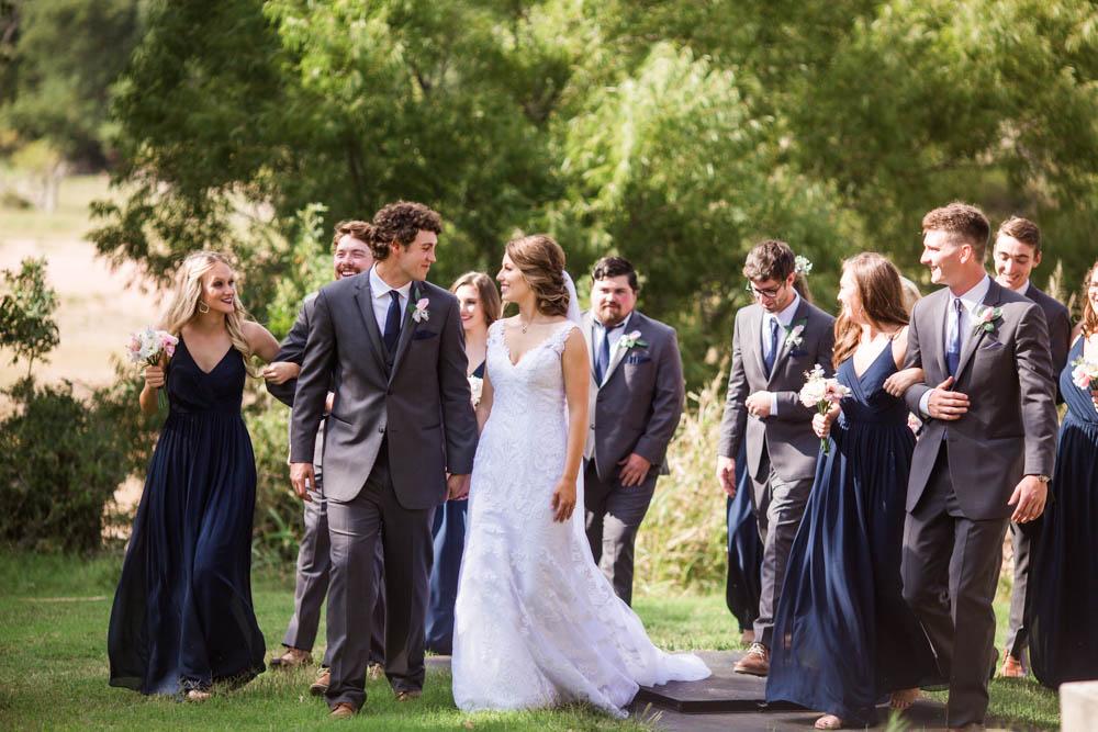 quartz mountain wedding oklahoma wedding photographer smiling bride norman lake beach mountains beach pretty woods bridal party