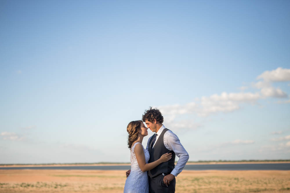 quartz mountain wedding oklahoma wedding photographer smiling bride norman lake beach
