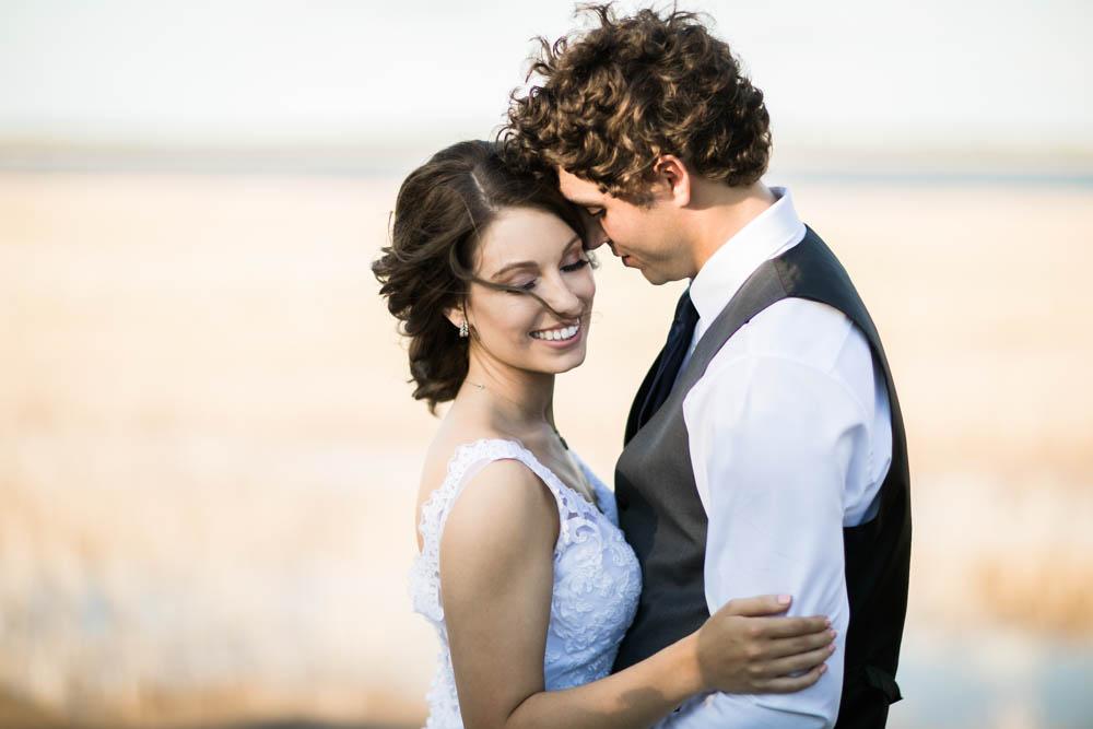 quartz mountain wedding oklahoma wedding photographer smiling bride norman lake beach
