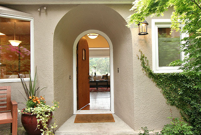 "Creeping fig and a ""Sango-kaku"" Japanese Maple enhance the front doorway"