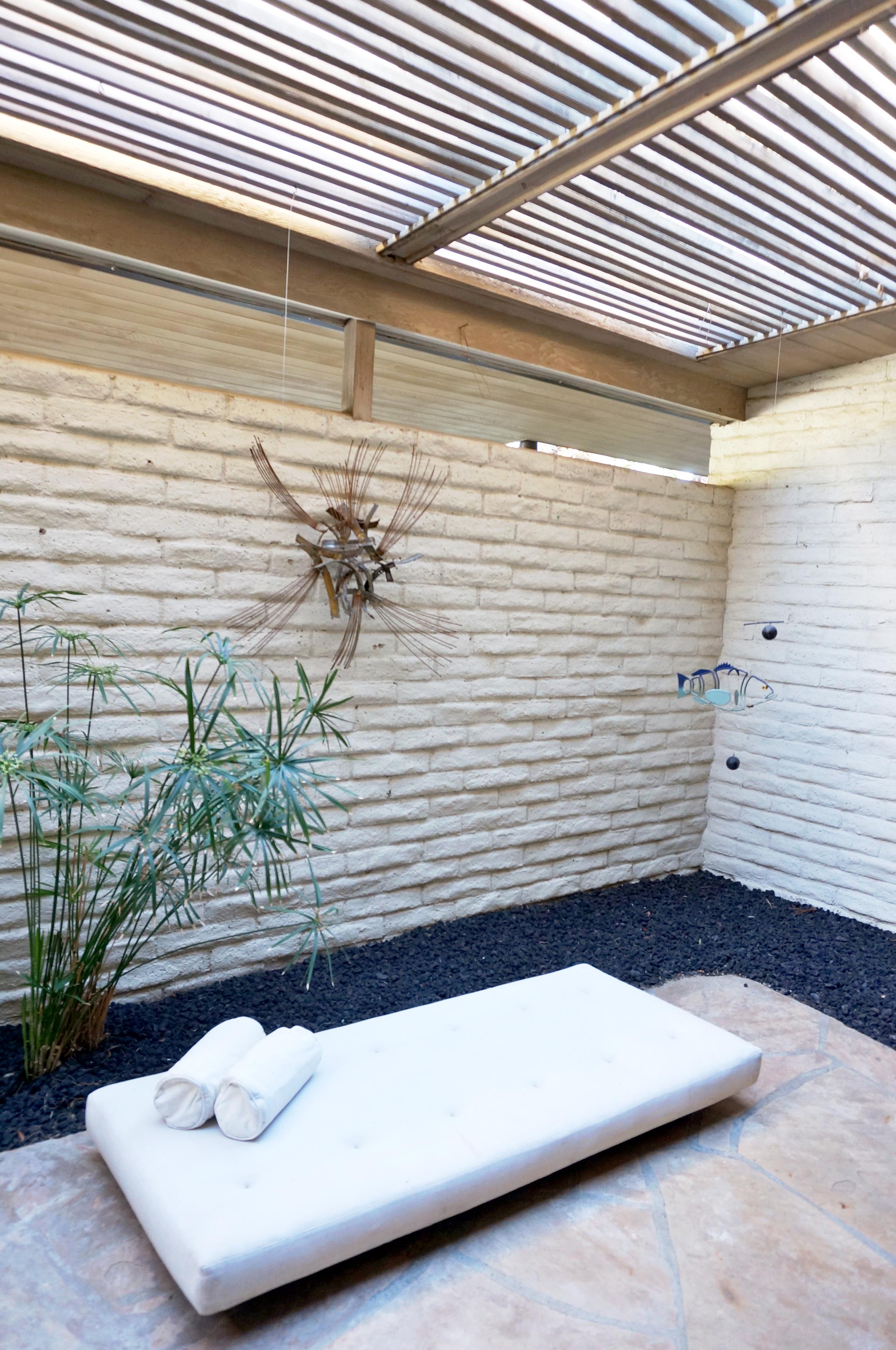 a peaceful atrium with a distinct Japanese influence