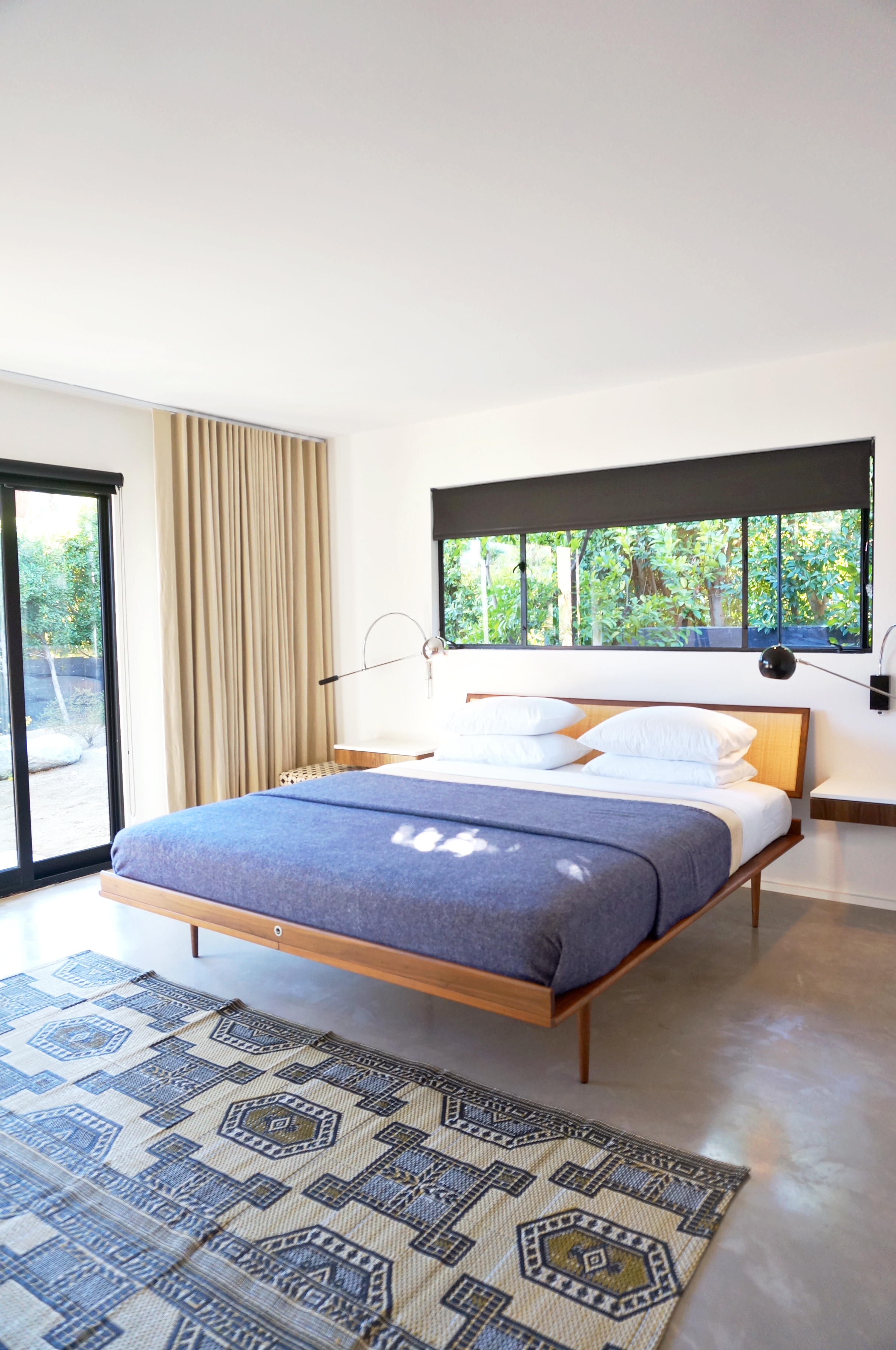 This room on the Signature House Tour felt a bit more modern than mid-century. Loved the bedframe!
