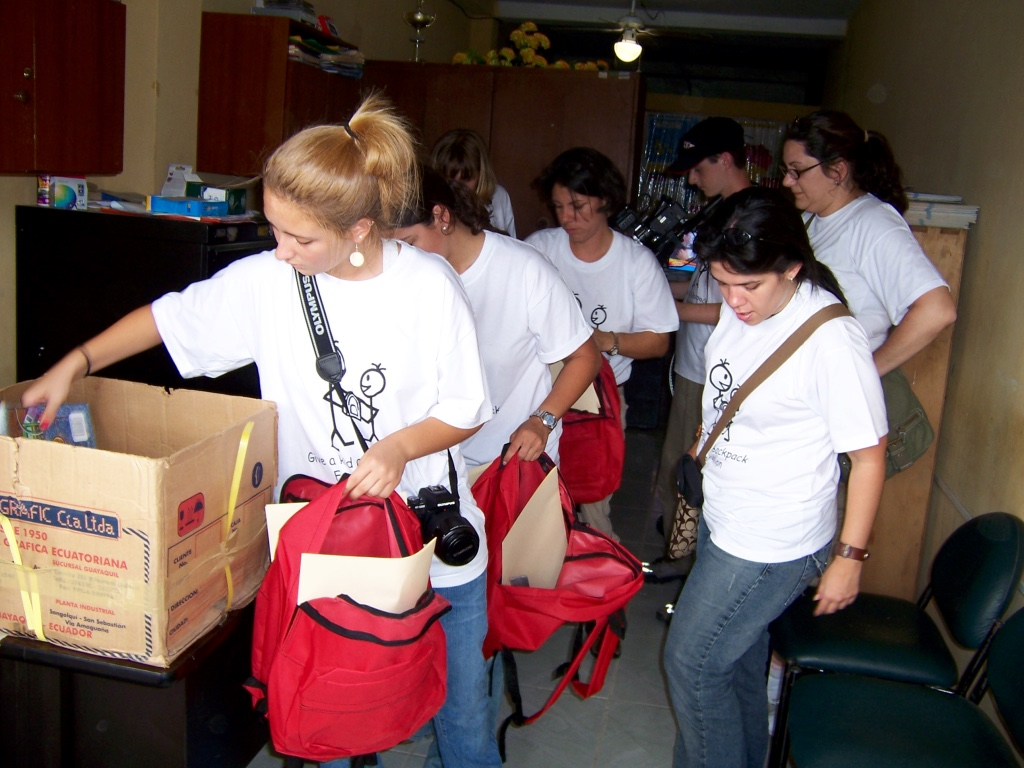 thumb_filling the 400 back packs with scholol supplies_1024.jpg