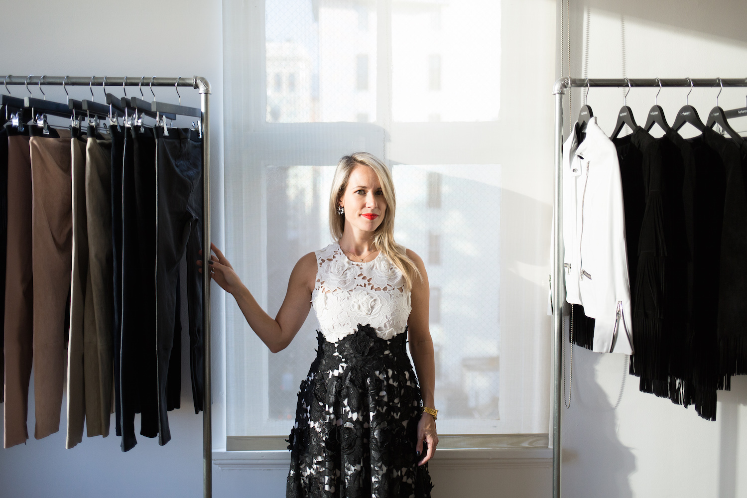 """""""The first look is a black and white color blocked lace midi length  Michelle dress. I love festive dressing each season, it's a time to embrace the idea of getting dressed up."""""""