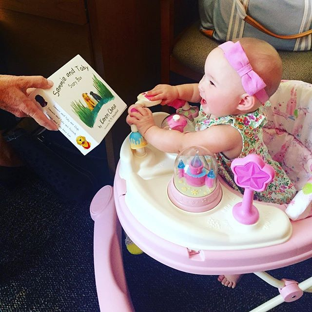 "In honor of the launch of our third book of the Sammie and Toby series, ""Sammie and Toby have Fun"", we will be posting pictures of our little readers who love Sammie and Toby!  This first picture is the happiest, most precious bundle of joy, Emily.  She absolutely lights up when she sees her Sammie and Toby books. @kristincr9  @kkimbrochase @terrisbeach"