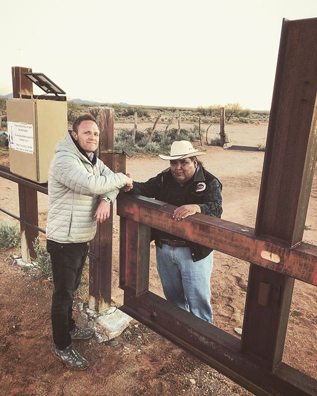 THE WALL // I've been filming a story for PBS (@newshour) this week on the complicated story surrounding plans for a border wall being built through the Tohono O'odham Nation in Southern Arizona.  This photo show Correspondent Chris Livesay and Vice Chairman Verlon Jose shaking hands across the wall into Mexico.  There should be more handshakes like this in the world.  The film premieres on PBS at the end of January. #tohonooodham #thewall