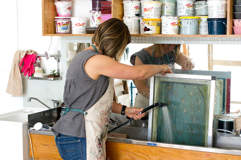 Leslie Keating cleaning a screen in the old hairdresser wash trough. Photo by Susan Fitzgerald.