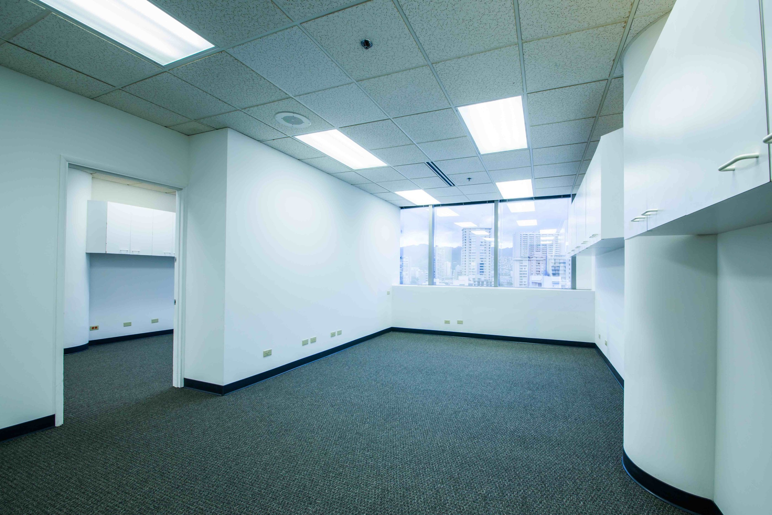 Suite is divided into two parts with an interior connecting door for flexible configuration.  Each area of the office has an independent hallway door for separate entrances into the suite. Wall to wall window views of Kalakaua Avenue.
