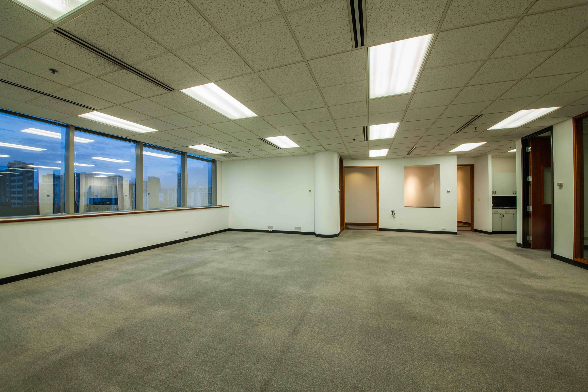 Spacious suite with four private offices. Window views of Waikiki, and the ocean. Kitchen with running water. Ideal office for large company.