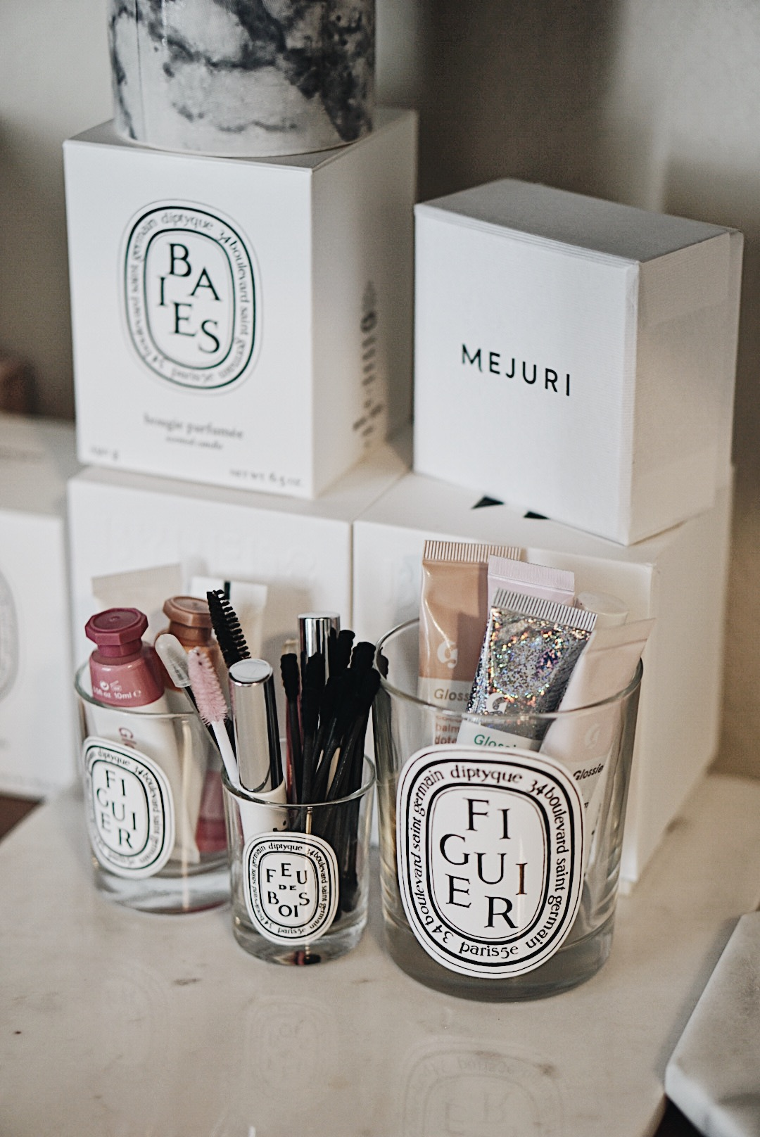 Repurposed Diptyque Jars and Glossier Products