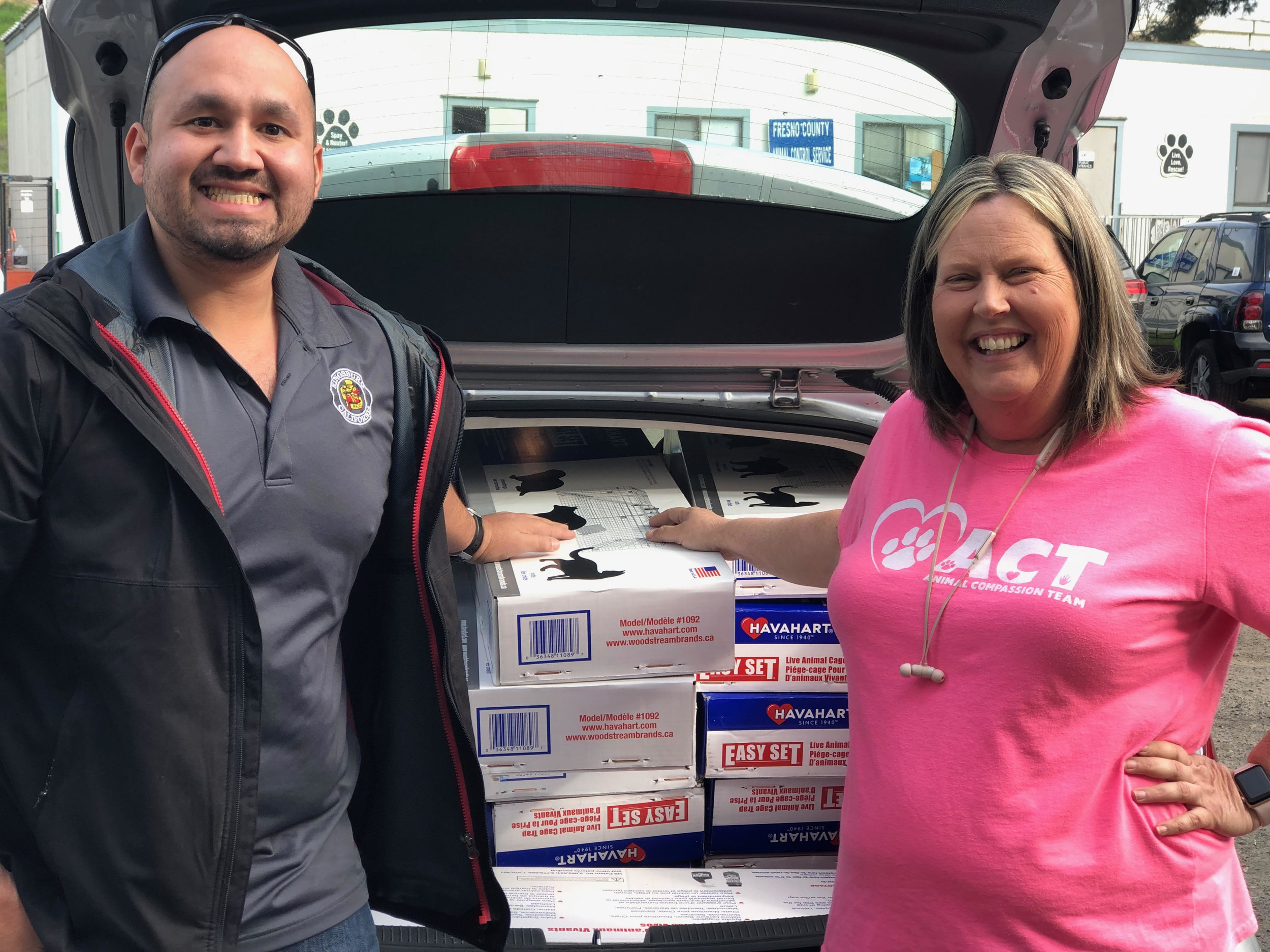 Pictured is Adam Castaneda, Community Services Director for the City of Kingsburg and Brenda Mitchell, President & Chief Life-saving Officer for Fresno Humane Animal Services posing with a full trunk of new cat traps bought with monies from a $5,000 grant gifted by an anonymous donor.