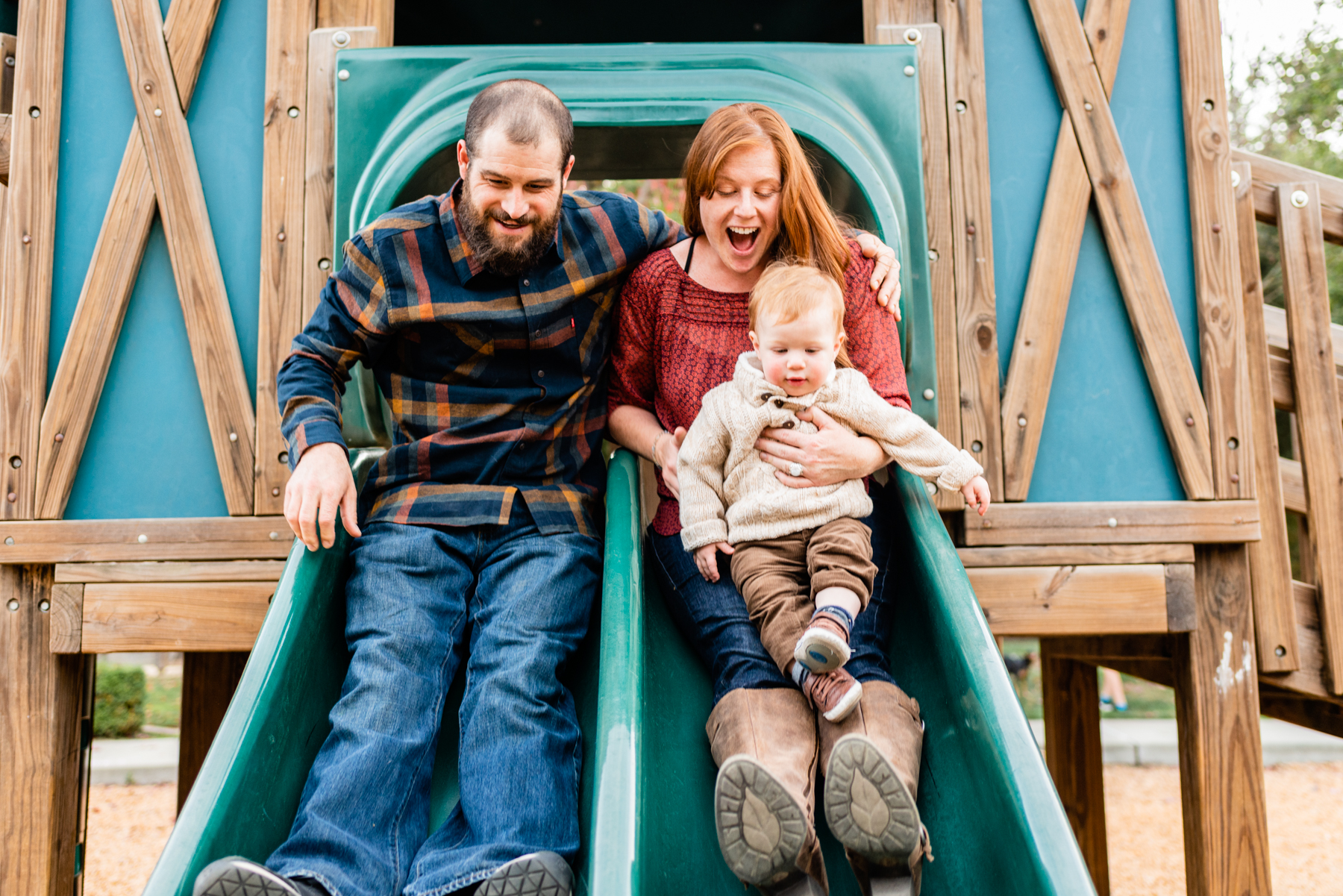 Fun at the playground at a family lifestyle session at Hap Magee Park