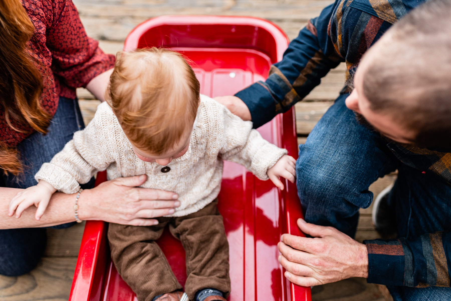 Family lifestyle with wagon on bridge at Hap Magee Park.