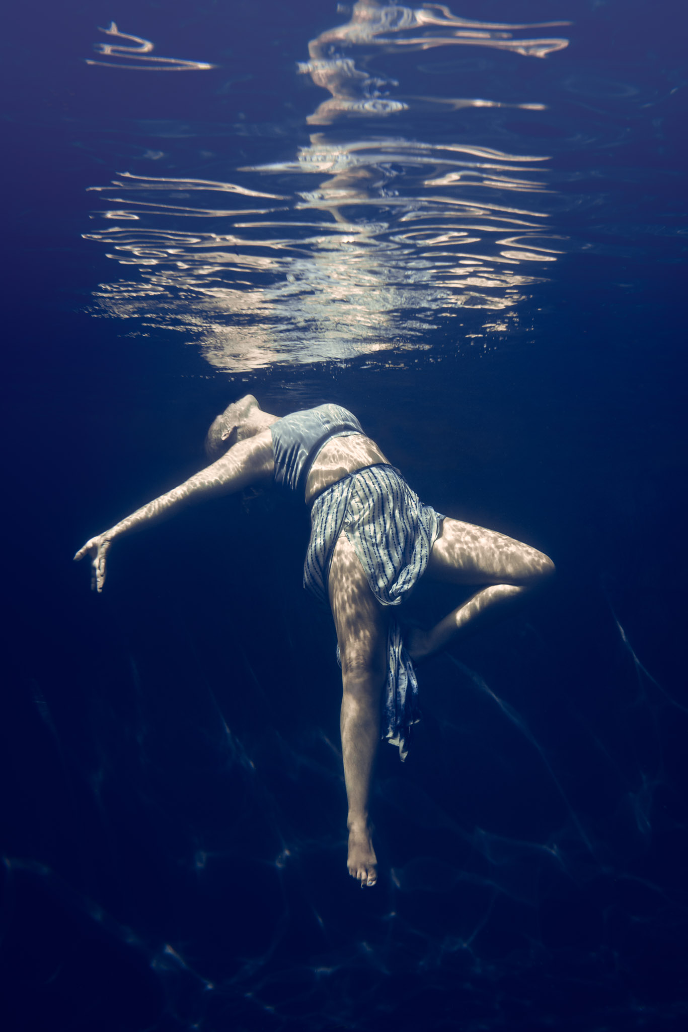 Becky Hammel, a yoga instructor models underwater for new yoga and underwater photography experience in Pleasant Hill, CA.