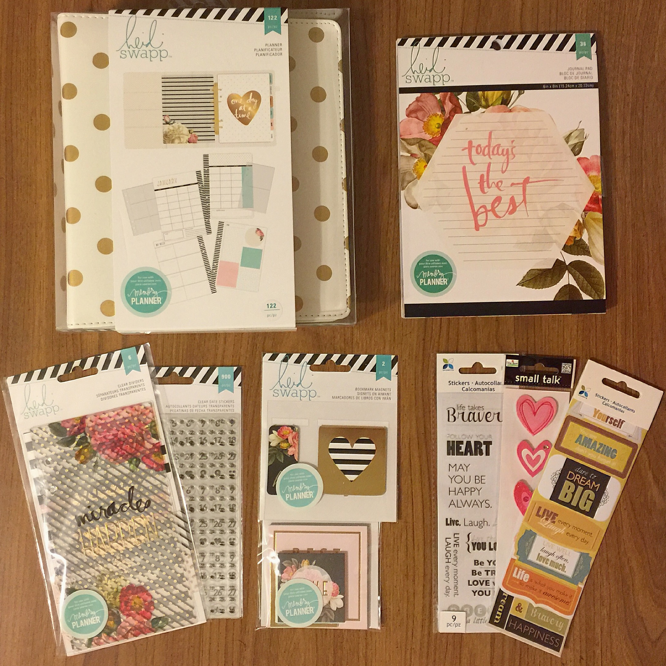 "(From left to right) I purchased the Heidi Swapp planner, the ""Today's the Best"" notebook, stickers from Michael's, Heidi Swapp bookmark magnets and quote cards, and Heidi Swapp number stickers and planner dividers."