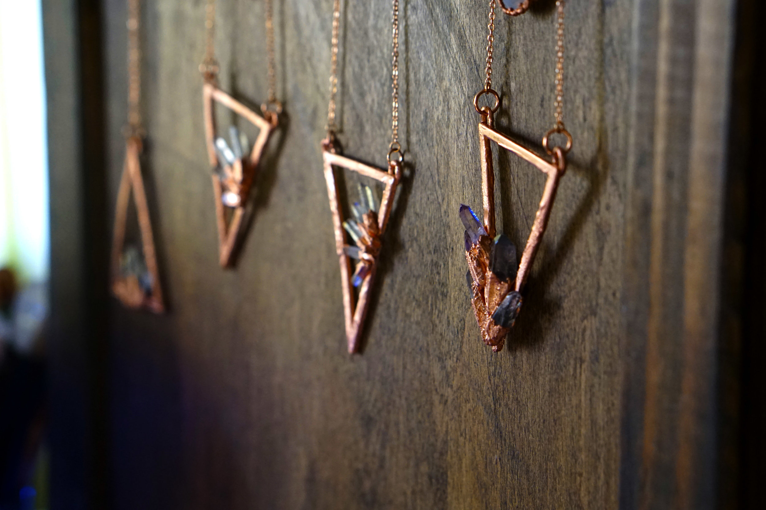 Crystal Caves Sacred Triangle from  desertdaisyjewelry.com