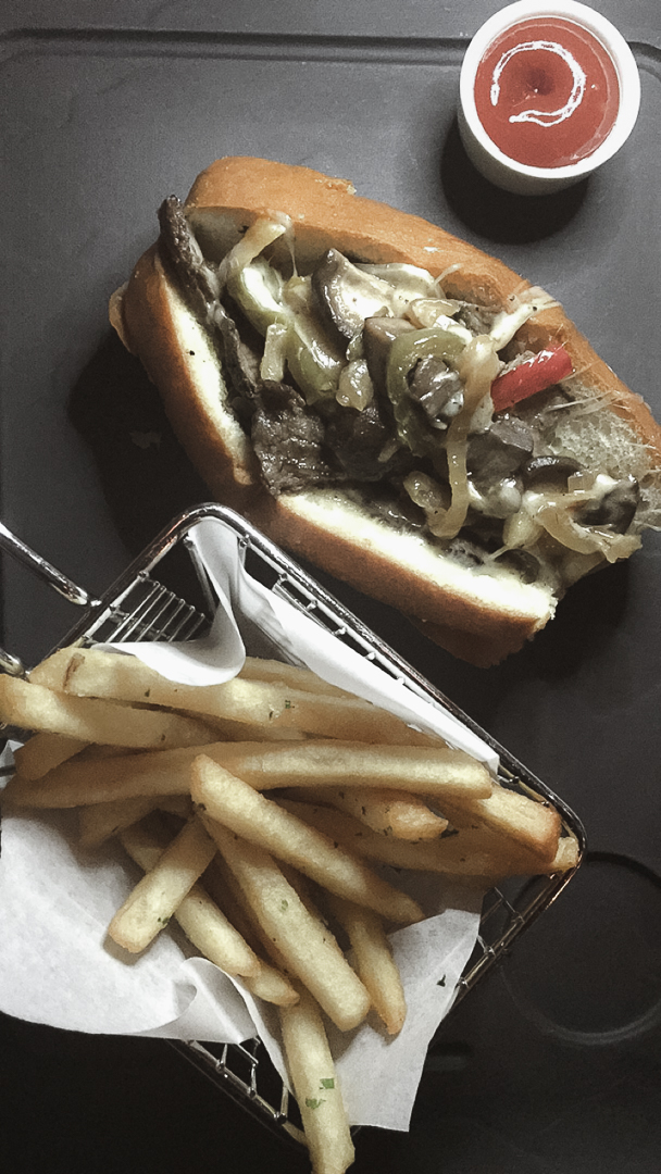 Petit Cheese Steak sandwich and fries. The fries were bomb.com!