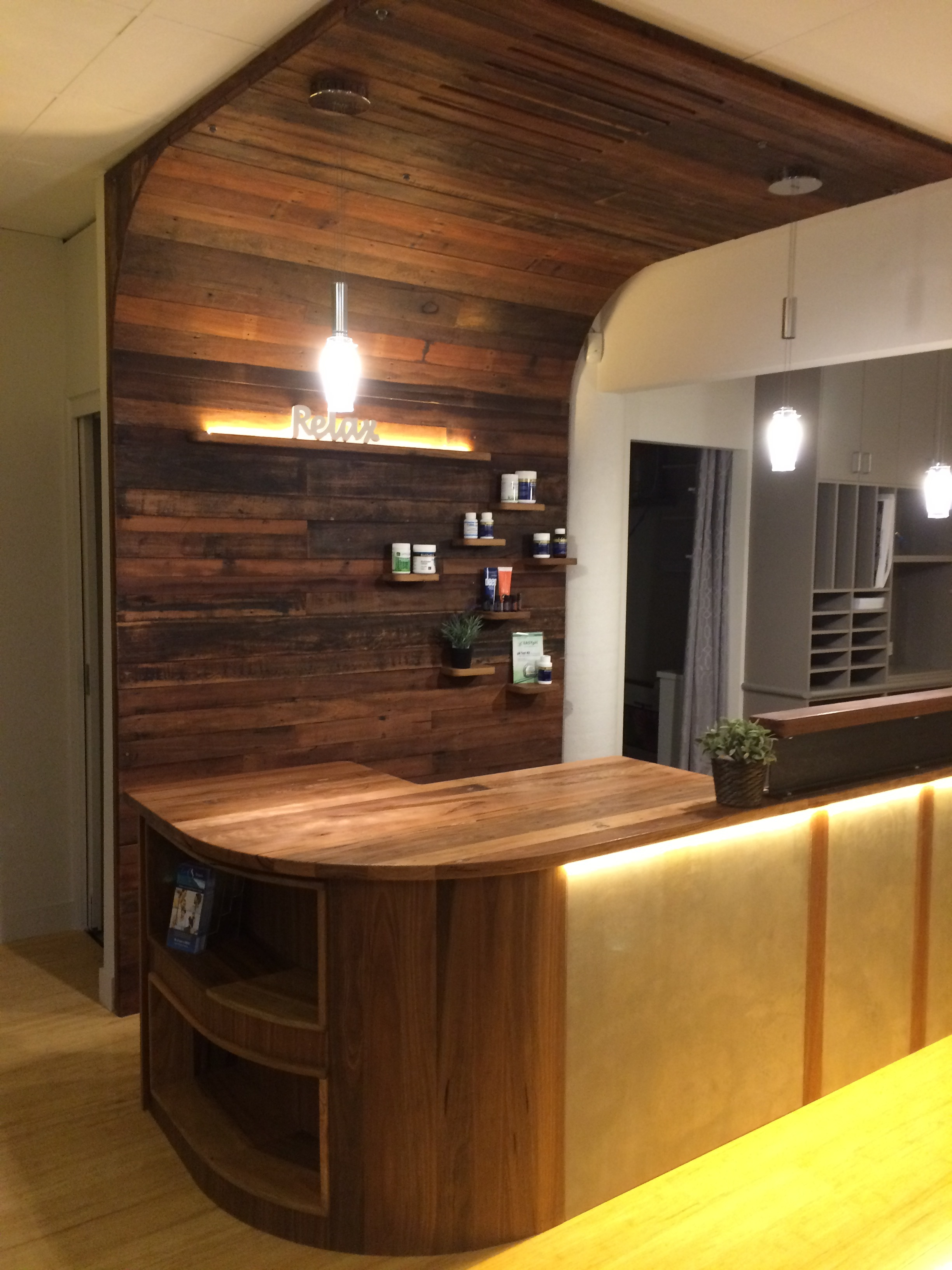 This Reception Desk is made out of Recycle timber and Concrete with a Recycle timber back wall to add warmth to the space.