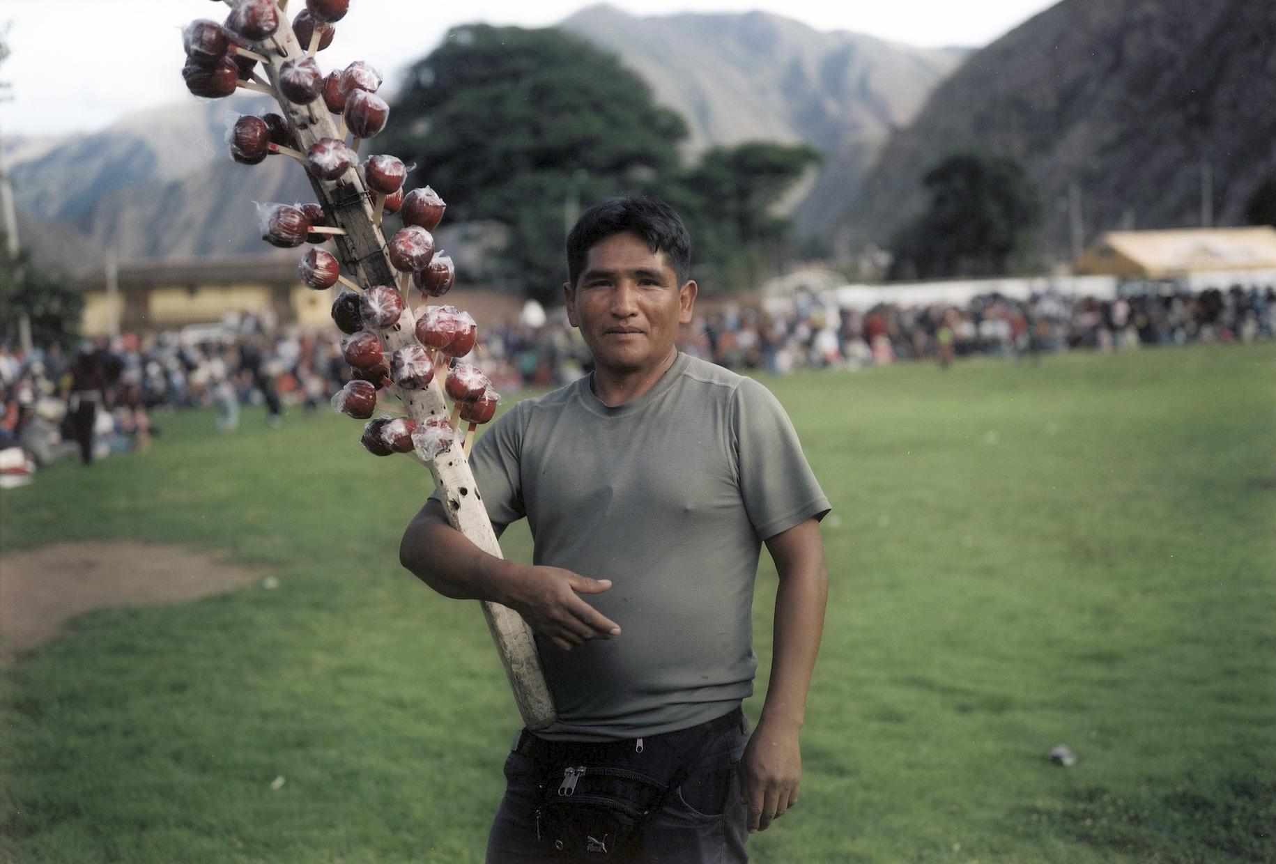 Candyseller, Fiesta at Urubamba, Peru