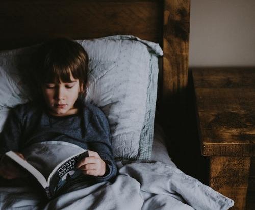 boy reading in bed.jpeg