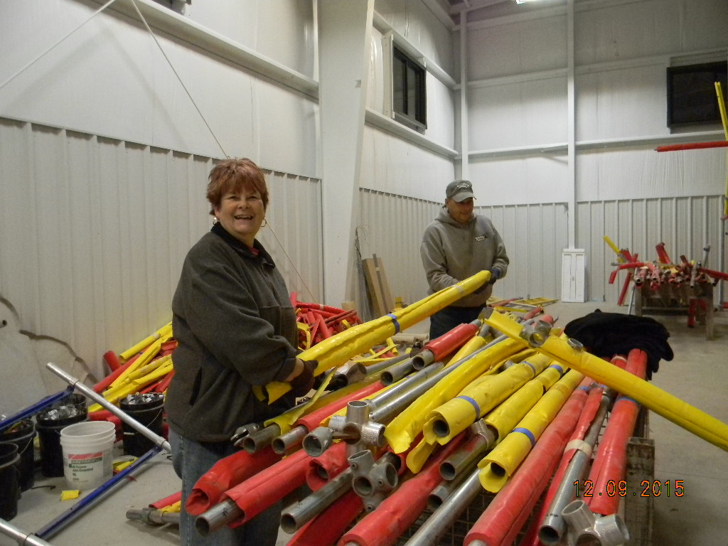 Pam Verhoff and Dave Sabo from the Bellevue Rotary Club helping catalog parts