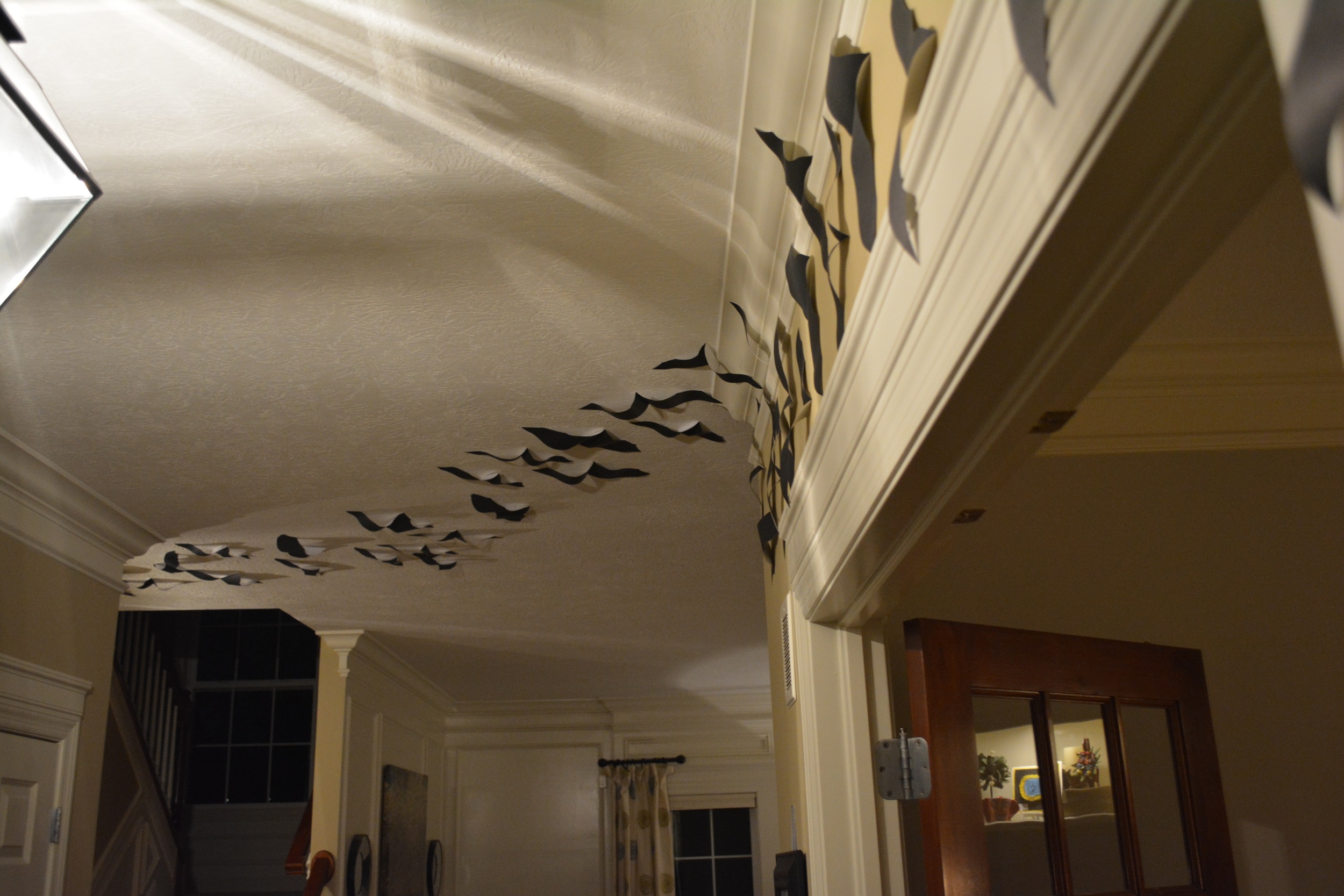 """I thought I'd share our last year's theme, we nick-named our home """"the Bat Cave"""" ~ we had a trail of bats from the entry way, clear through the hallway and into the Kitchen!"""