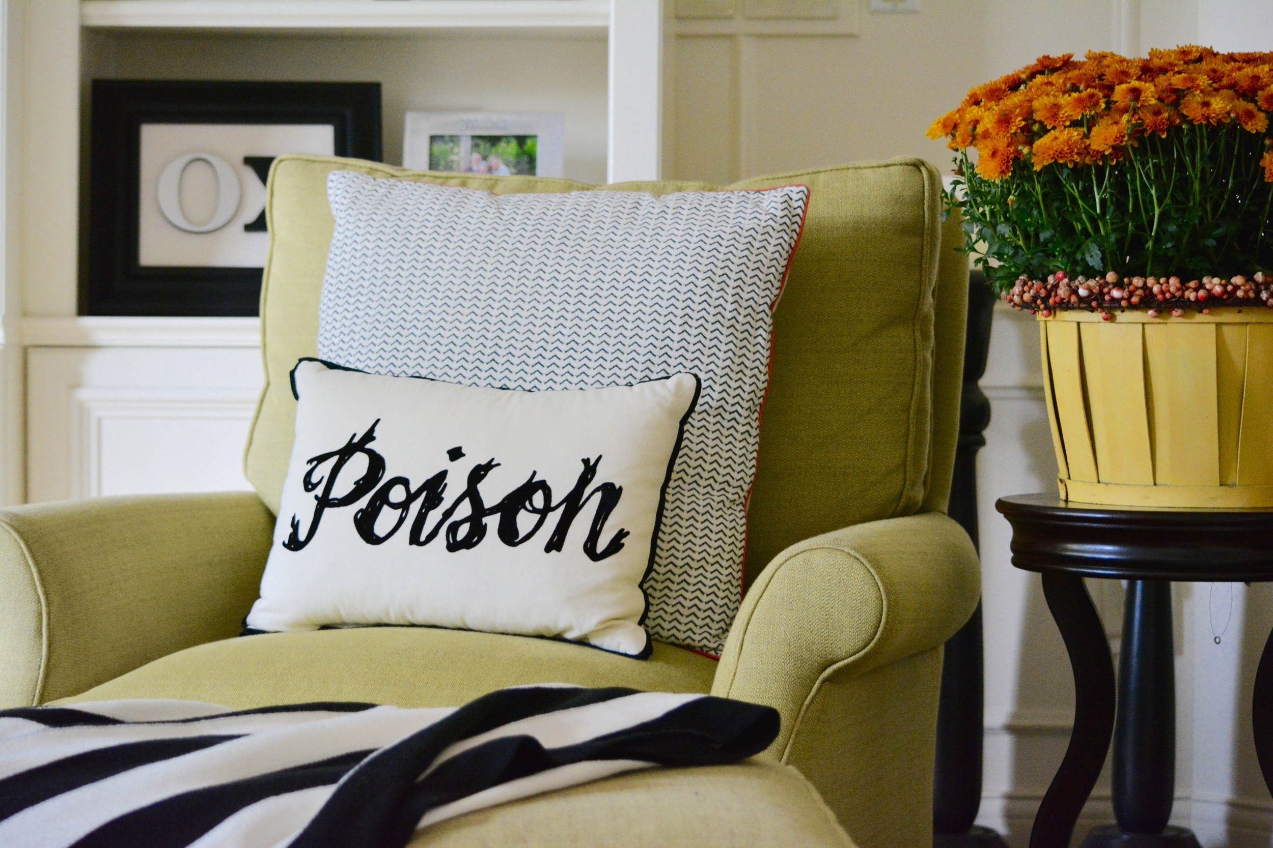 I think pillows can add such an impact, yet are so easy to switch out and are pretty affordable.  I found this poison one at Target (of course!) last year, and the cute black/orange one behind it is from Pottery Barn.