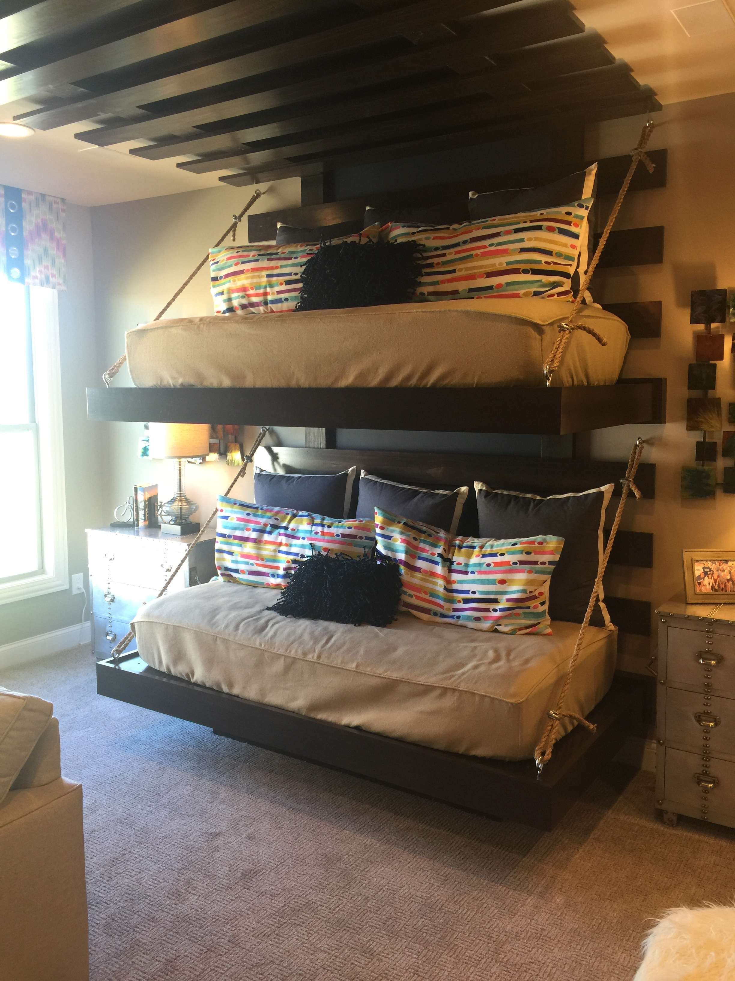 Alternative to traditional bunk beds?? Actually, this is a bonus room above the kitchen area, and was being used as a Media Room. Creative idea ~ and I can see my kids loving the top bunk to hang out and read a good book or write a story.