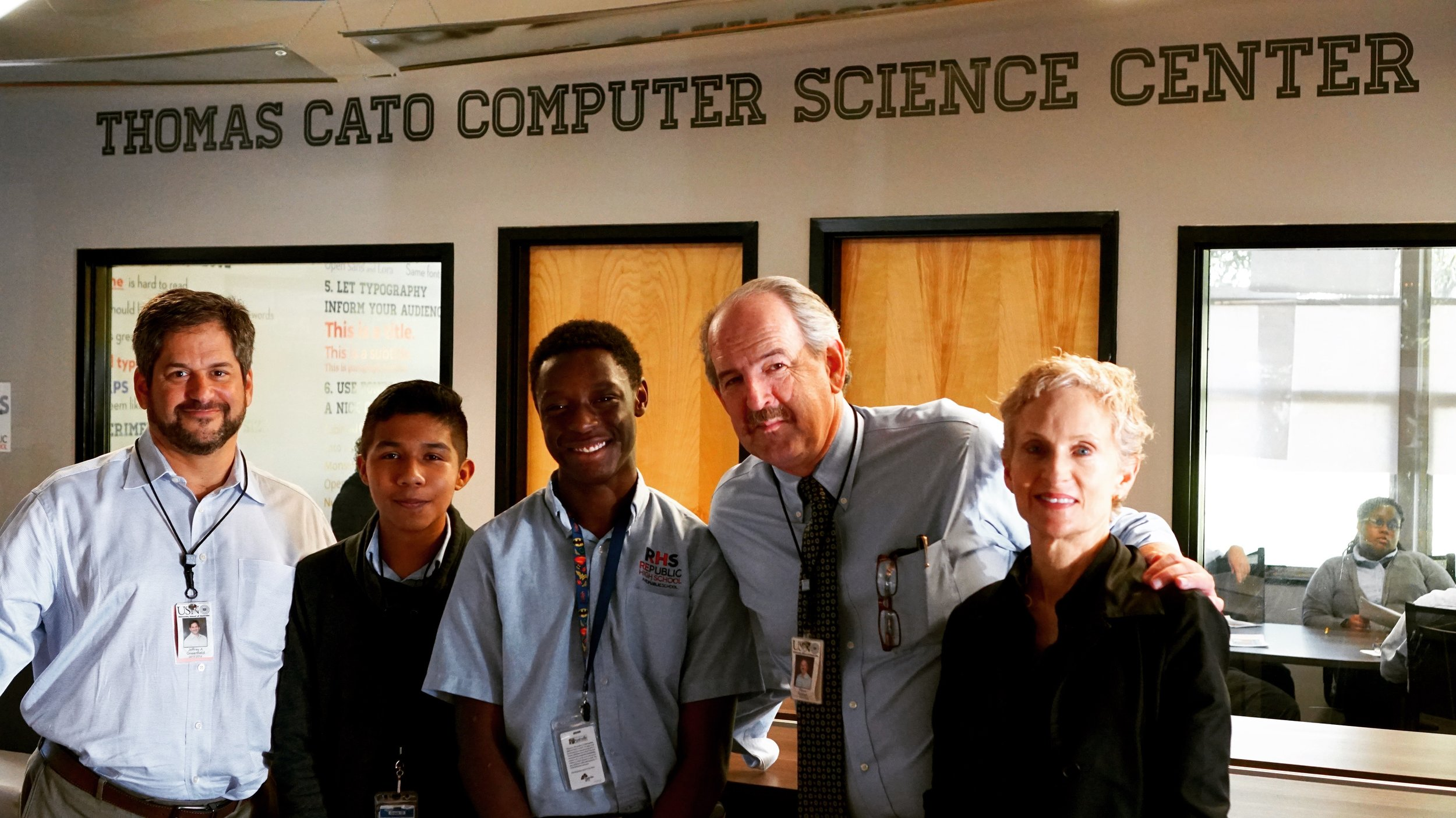Celebrating with students and faculty at the opening of the Thomas Cato Computer Science Center at RePublic High School.