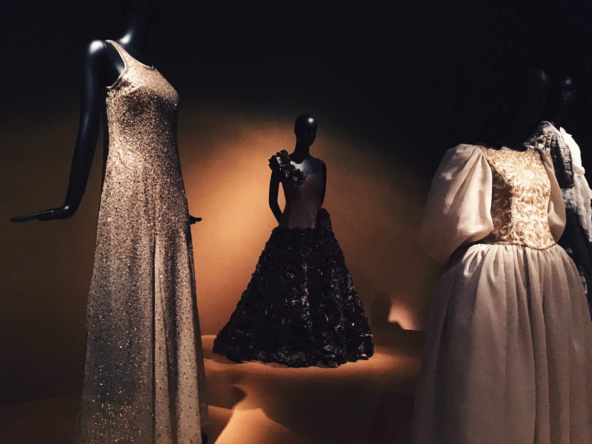 The silver sequined gown on the left was worn by former First Lady Laura Bush