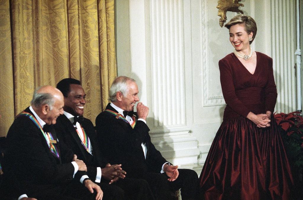Oscar De La Renta with Former First Lady Hillary Cilnton.Image from SF Gate.