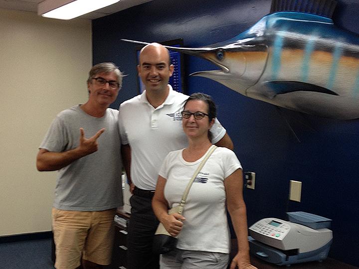 Pete, Mike, Deb, a marlin, and a postal machine.