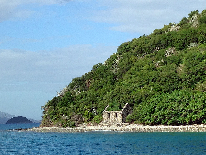 Bye bye USVI! Motoring past the ruins of a customs house on the shore of Whistling Cay, St. John.